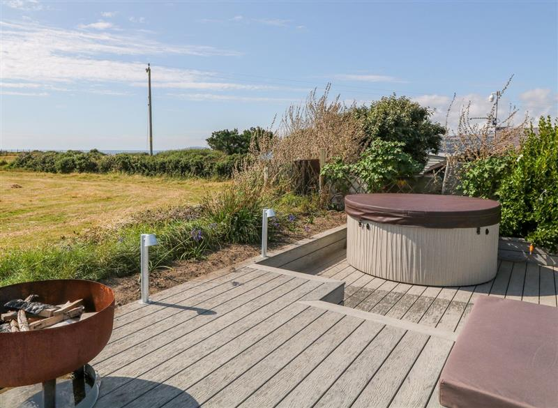 Garden and hot tub at 1 Bryn Llawen, Llanengan near Abersoch