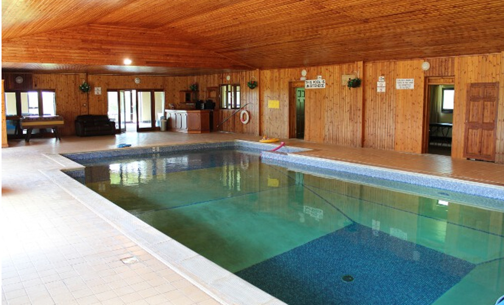 There is an indoor heated swimming pool at Sherrill Farm Holiday Cottages